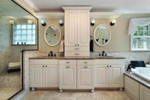 new bathroom remodel with new vanity cabinet and mirrors