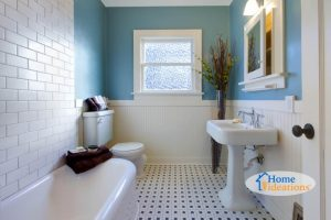 bathroom renovation from Wilmington home designed with blue wall and checkered tile