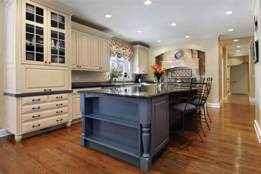 newly remodeled kitchen with gray island